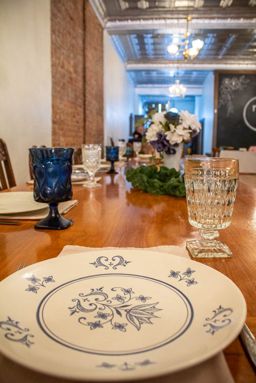 The site also features a full catering kitchen, a giant, customizable chalkboard, and all kinds of historic touches around every corner. The mismatched seating and table settings create a sort of rustic tea party vibe that's not only charming, but very different from most rentable spaces. / Image: Katie Robinson, Cincinnati Refined // Published: 10.7.19