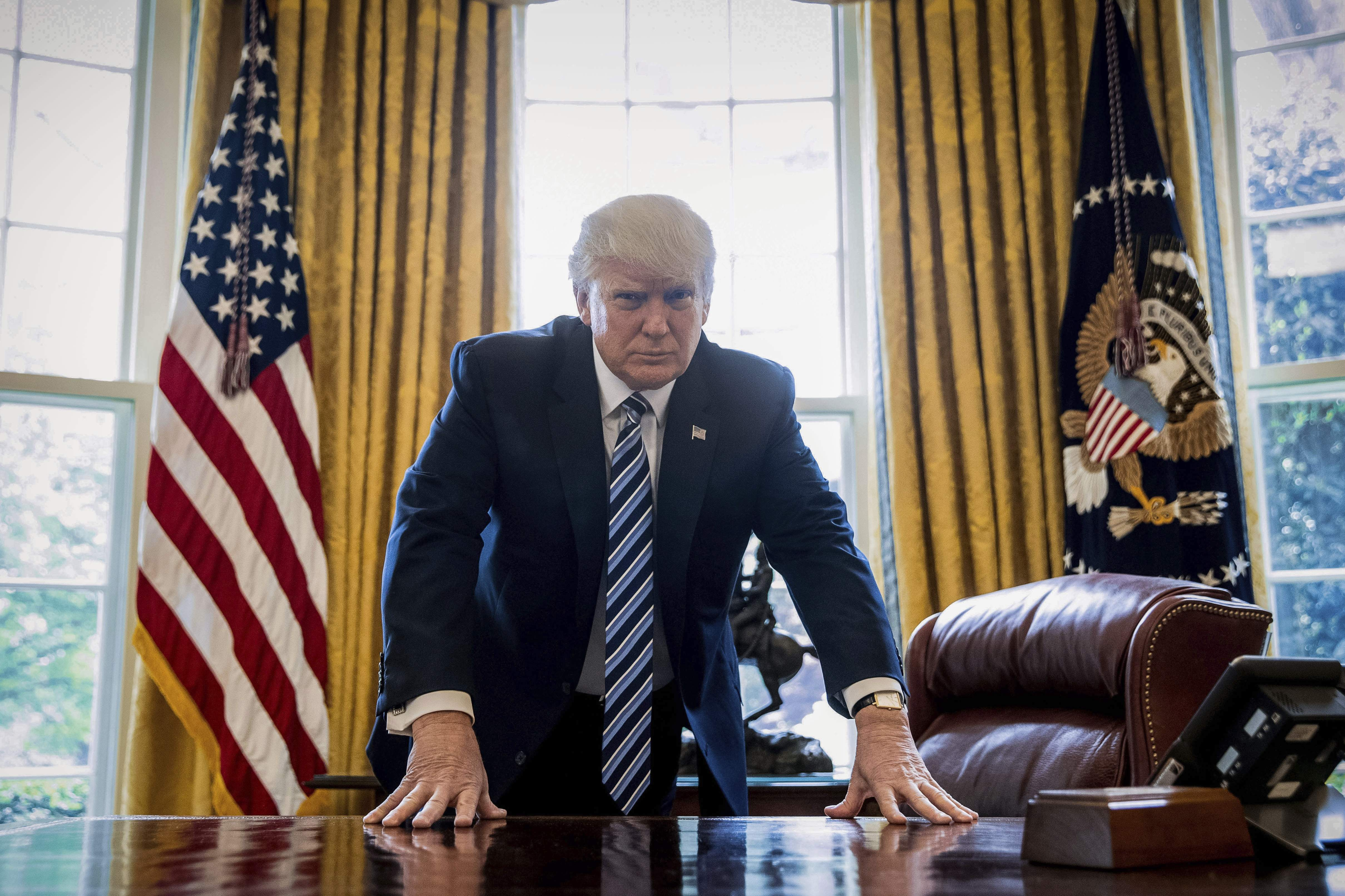 DAY 92 - In this April 21, 2017, file photo, President Donald Trump poses for a portrait in the Oval Office in Washington after an interview with The Associated Press. (AP Photo/Andrew Harnik)