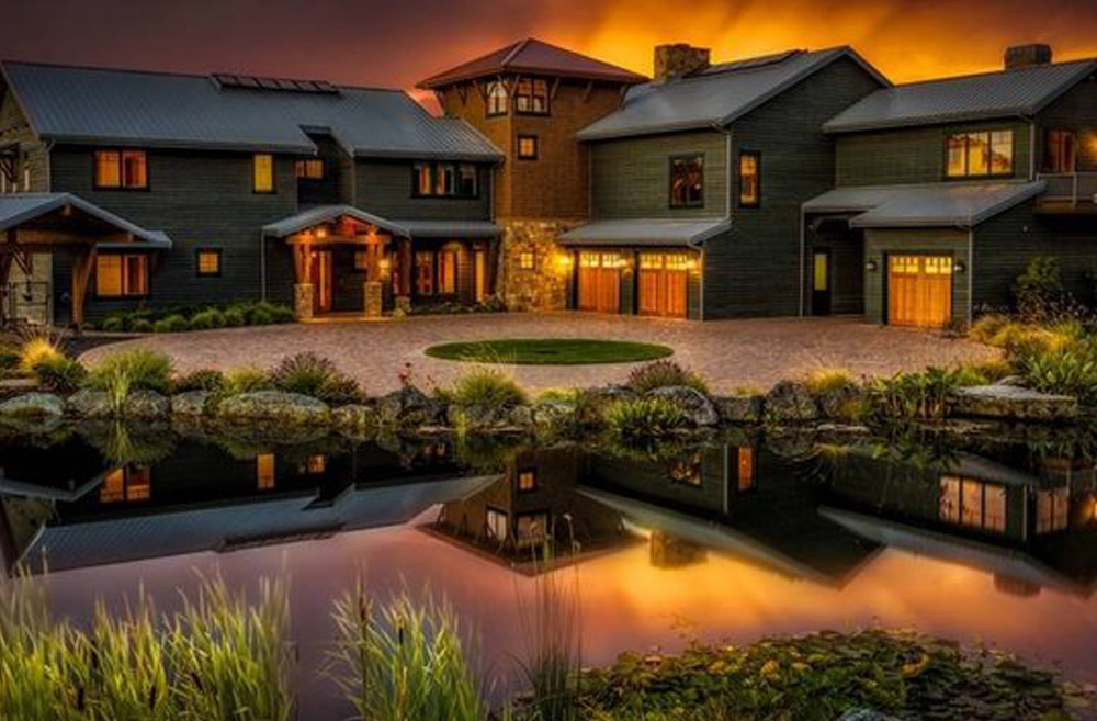 This Lake Front Retreat Anacortes, WA project was completed by Paulk Homes LLC and cost $4.5 million. The 7,000 square foot home includes a guest cottage, tennis court, Olympic sized swimming pool, helicopter landing pad, trout pond, and more.   (Image: Lake Front Retreat / Porch.com)
