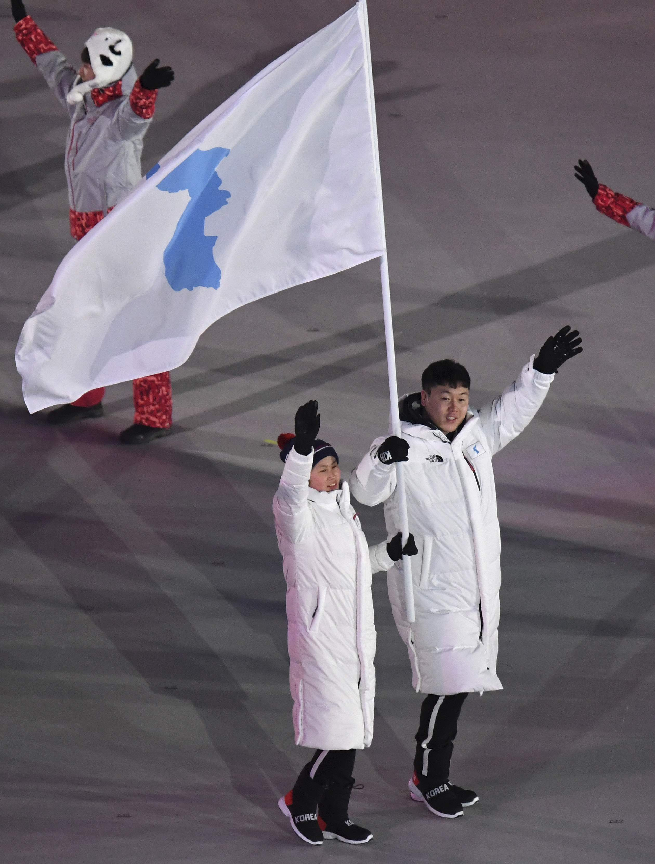 North Korea's Hwang Chung Gum and South Korea's Won Yun-jong arrive during the opening ceremony of the 2018 Winter Olympics in Pyeongchang, South Korea, Friday, Feb. 9, 2018. (Franck Fife/Pool Photo via AP)