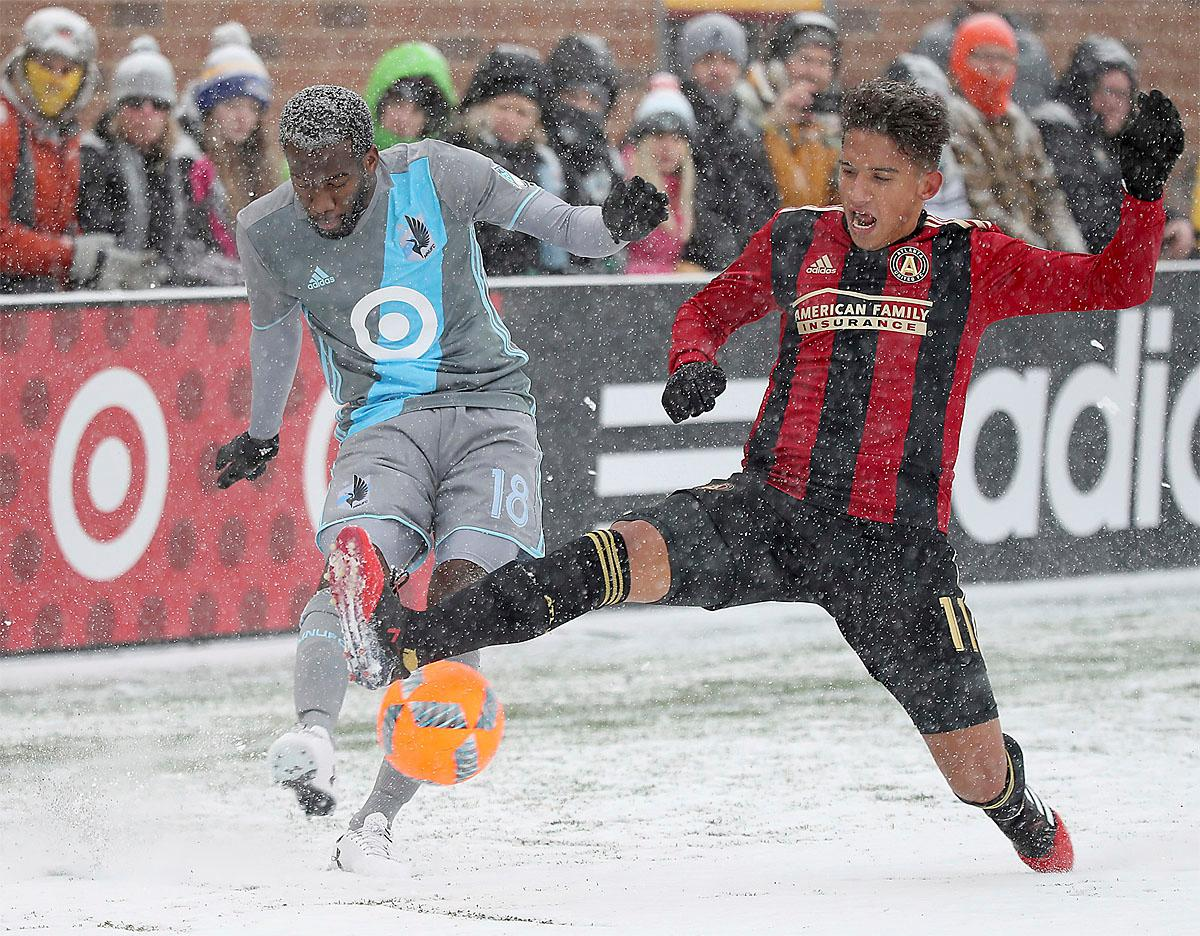 Minnesota United midfielder Kevin Molino and Atlanta United midfielder Yamil Asad battles for the ball during the first half of an MLS soccer match Sunday, March 12, 2017, in Minneapolis, (Elizabeth Flores/Star Tribune via AP)