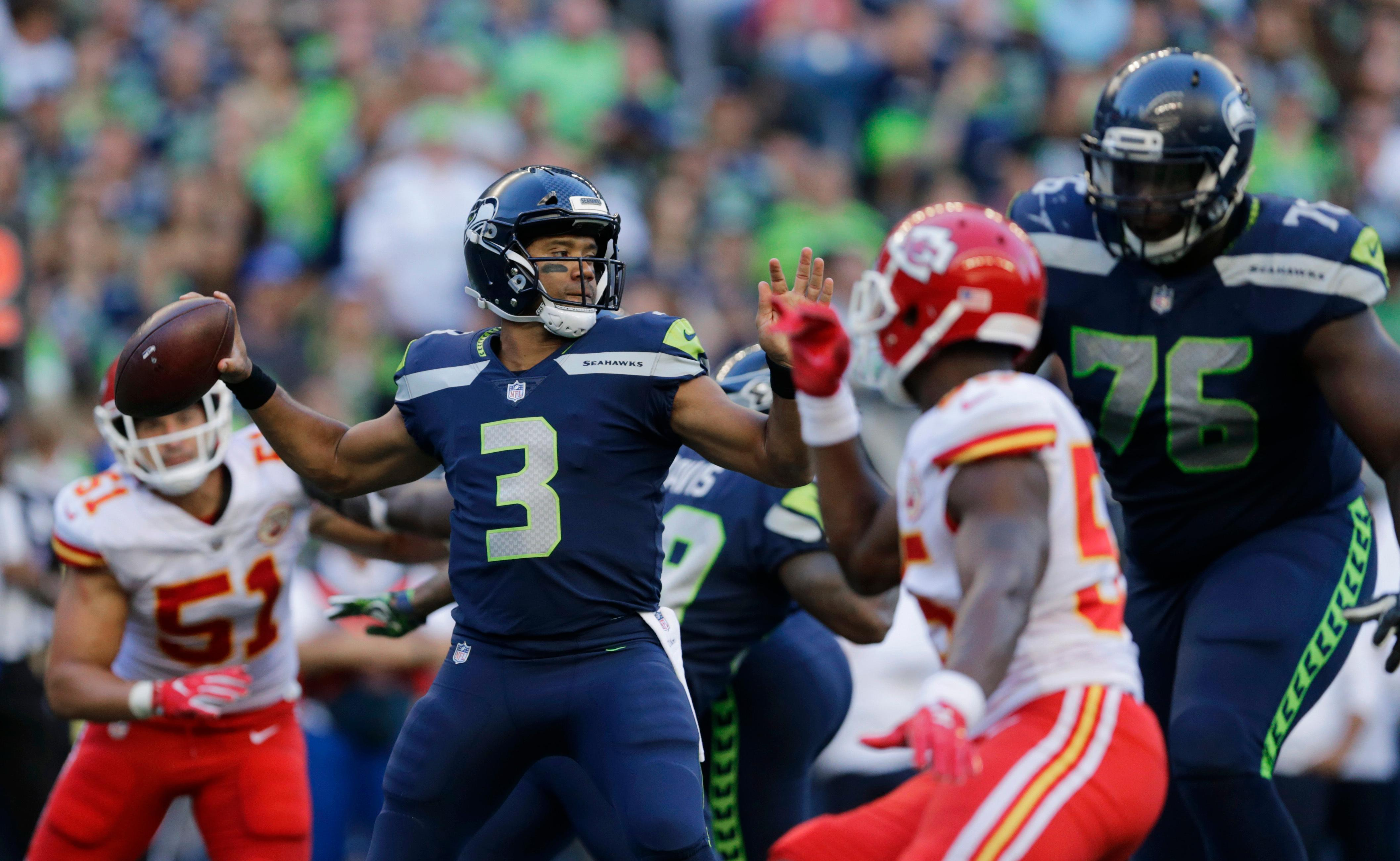 Seattle Seahawks quarterback Russell Wilson (3) looks to pass against the Kansas City Chiefs during the first half of an NFL football preseason game, Friday, Aug. 25, 2017, in Seattle. (AP Photo/John Froschauer)