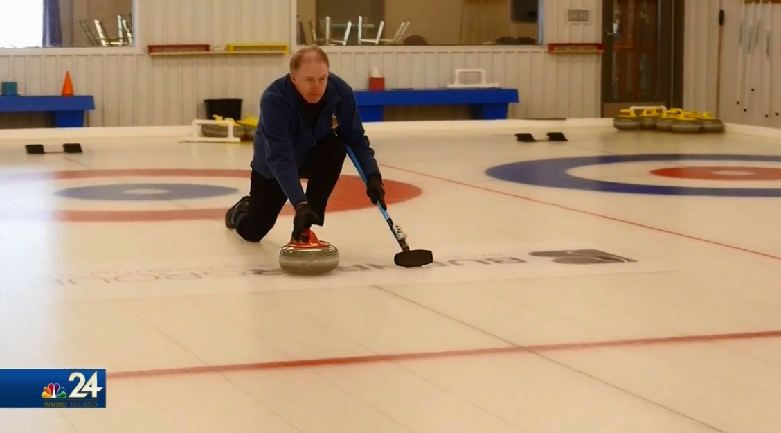 Setting up a draw, curler Scott Helle lines up his shot (WNWO)<p></p>