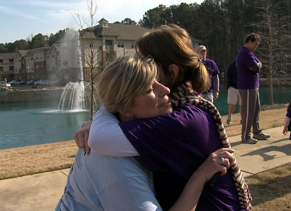 ABC 33/40's Brenda Ladun gets a hug from Cynthia Castleberry at the 9th Annual Brenda Ladun Conquer Cancer Run on Saturday, March 9, 2013.