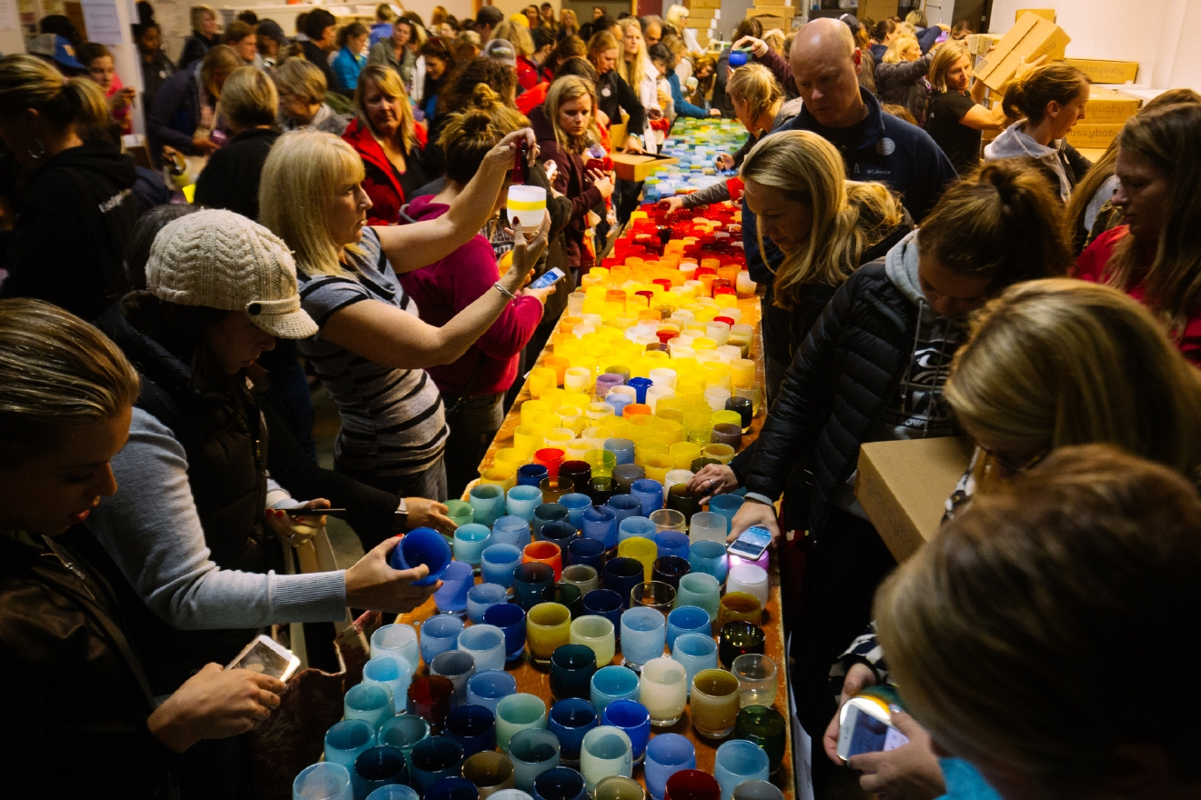 Hundreds of shoppers packed the glassybaby warehouse in South Seattle for their renown Seconds Sale. Anything that was deemed not perfect for the retail store or older designs are sold for discounted prices. Shoppers lined up hours before doors opened at the chance to get their hands on these perfectly imperfect glassybaby. June 11th 2016. (Image: Joshua Lewis / Seattle Refined)