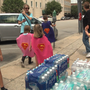 Little superheroes bring water to Columbia homeless