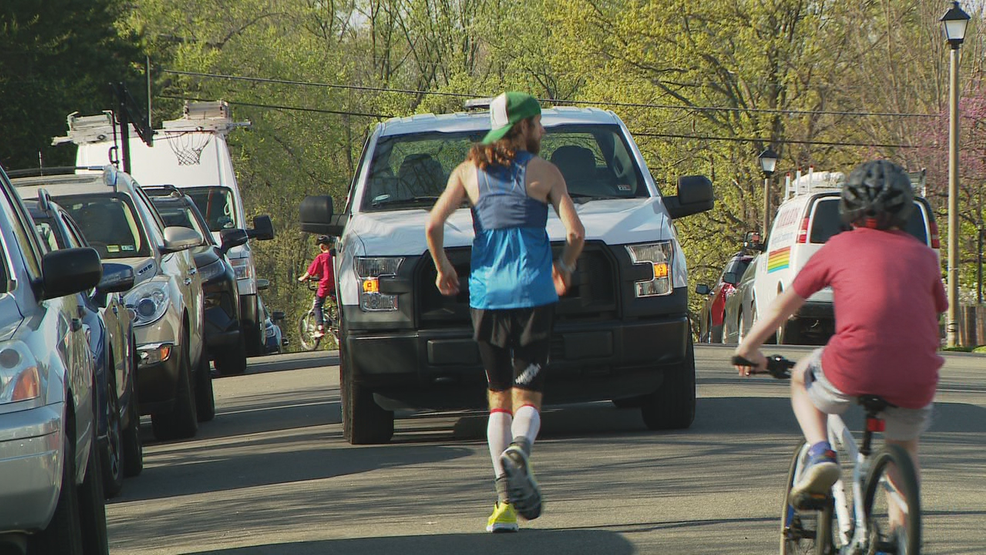 Man running marathon in his neighborhood