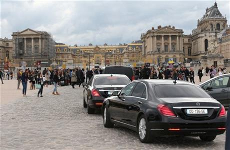 Fans gather to watch guests arriving, as they look for Kim Kardashian, Kanye West and their guests, at the entrance of the Chateau de Versailles in Versailles, France, west of Paris, Friday, May 23, 2014.