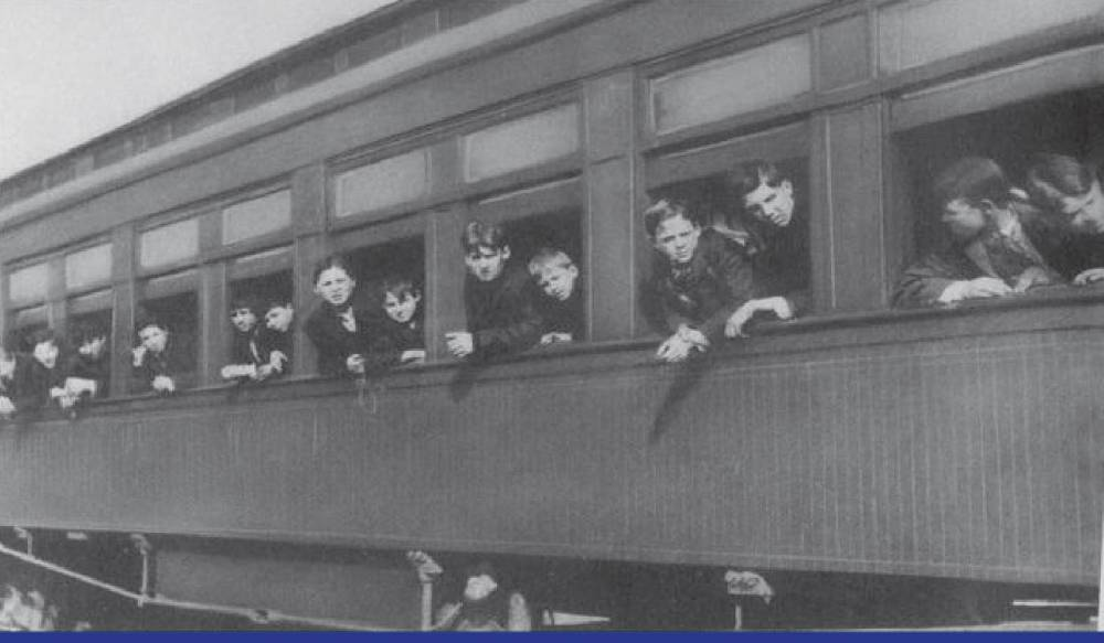 <p>Child passengers on the orphan train stick their heads out the window of the train as they made their way from New York to destinations elsewhere in the U.S. and Canada. (Photo from National Orphan Train Museum)<br></p><p></p>