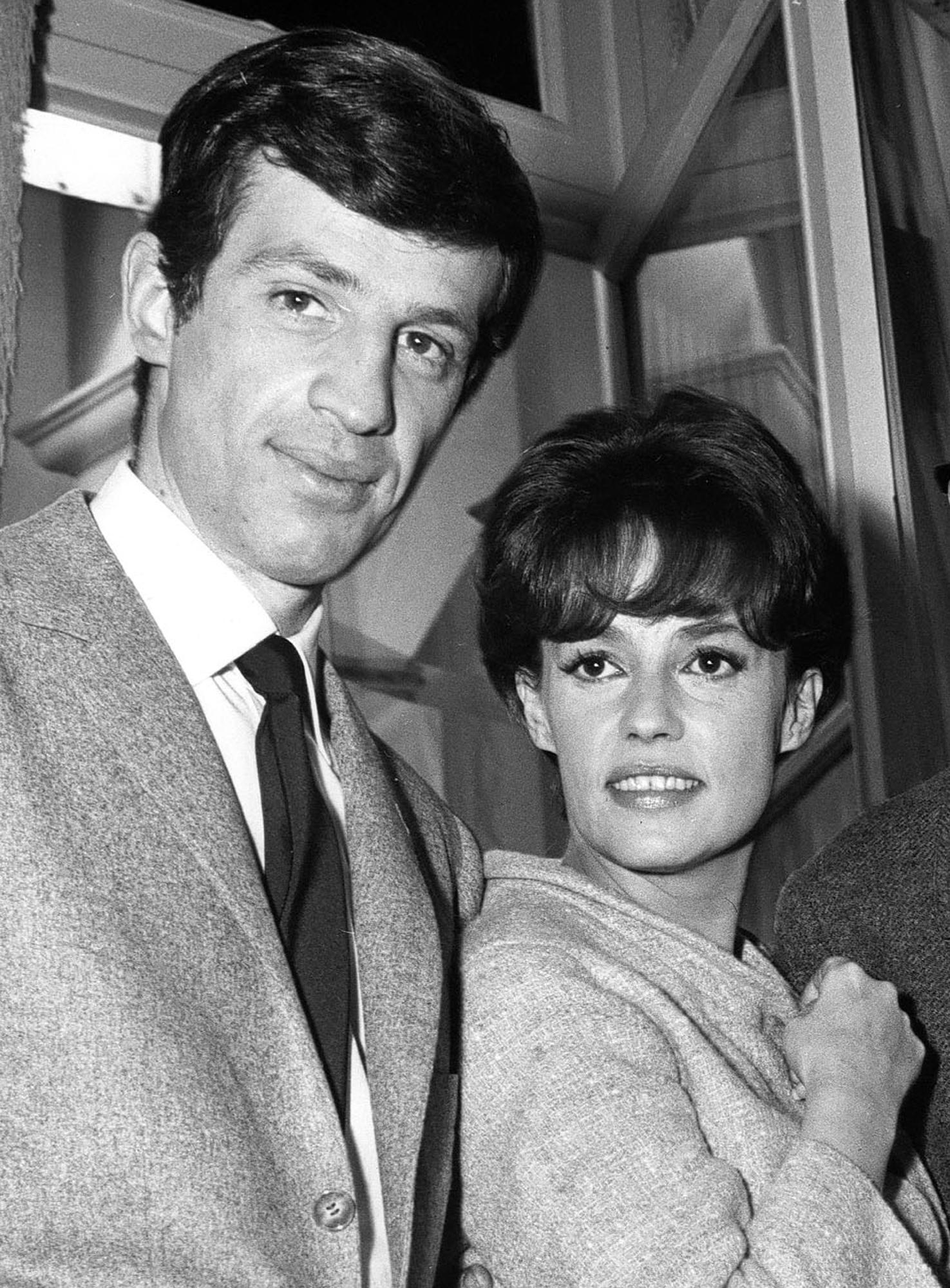 FILE - Undated file photo of Jeanne Moreau, right, and Jean Paul Belmondo and Jeanne Moreau at Billancourt studios near Paris. French actress Jeanne Moreau, whose seven-decade career included work with Francois Truffaut, Orson Welles, Wim Wenders and other acclaimed directors, has died aged 89 it was announced Monday July 31, 2017. (AP Photo/File)