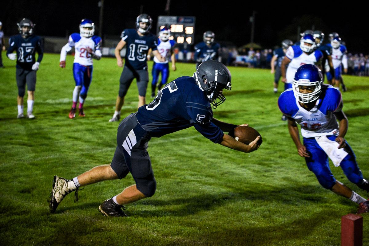 Springfield quarterback Charlie Grousbeck (#5) steps out of bounds while diving for the end zone during the Millers 56-7 loss to Churchill.  The Lancers remain undefeated at 7-0 on the season. Photo by Jeff Dean, Oregon News Lab