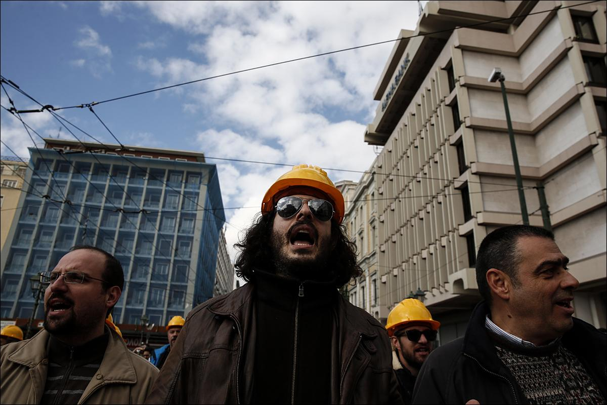 Engineers shout slogans as they march to the parliament during an anti-government rally in Athens, on Thursday, Jan. 21, 2016. Thousands of Greek lawyers, doctors, engineers and other professional groups marched peacefully through central Athens to protest new drastic income cuts under planned pension reforms. (AP Photo/Yorgos Karahalis)