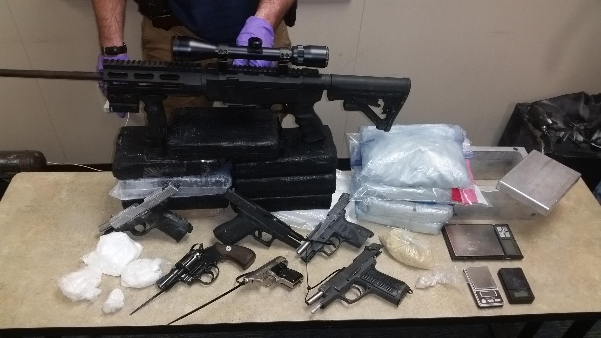 Seized drugs and weapons.jpg
