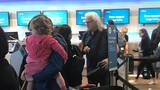 PHOTOS: Country star Ricky Skaggs helps & prays with passengers at the airport