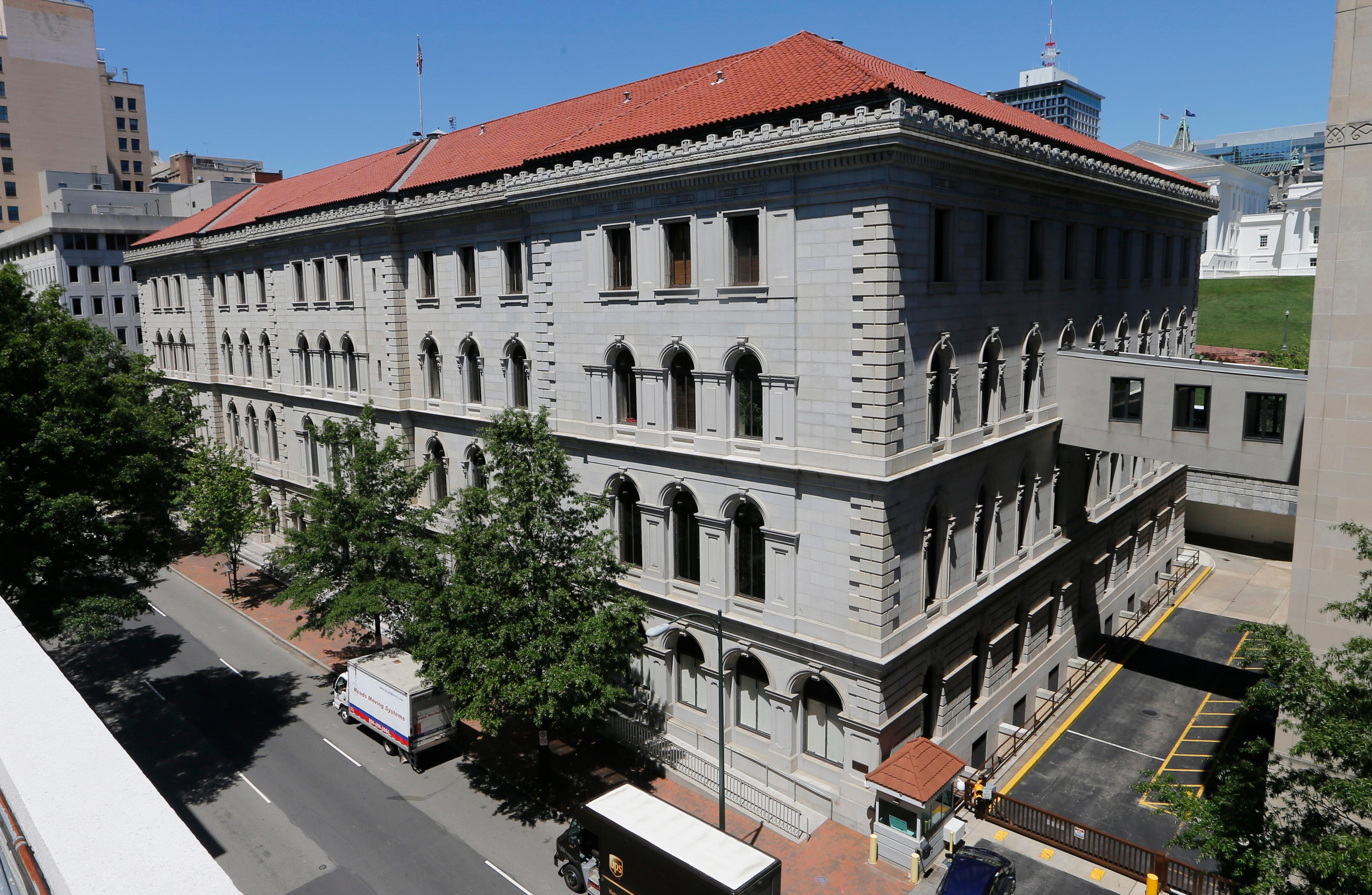 This Tuesday, May 2, 2017 photo shows the US 4th Circuit Court of Appeals building, the site of a full 15-member court hearing on President Donald Trump's revised travel ban targeting six Muslim-majority countries in Richmond, Va. (AP Photo/Steve Helber)