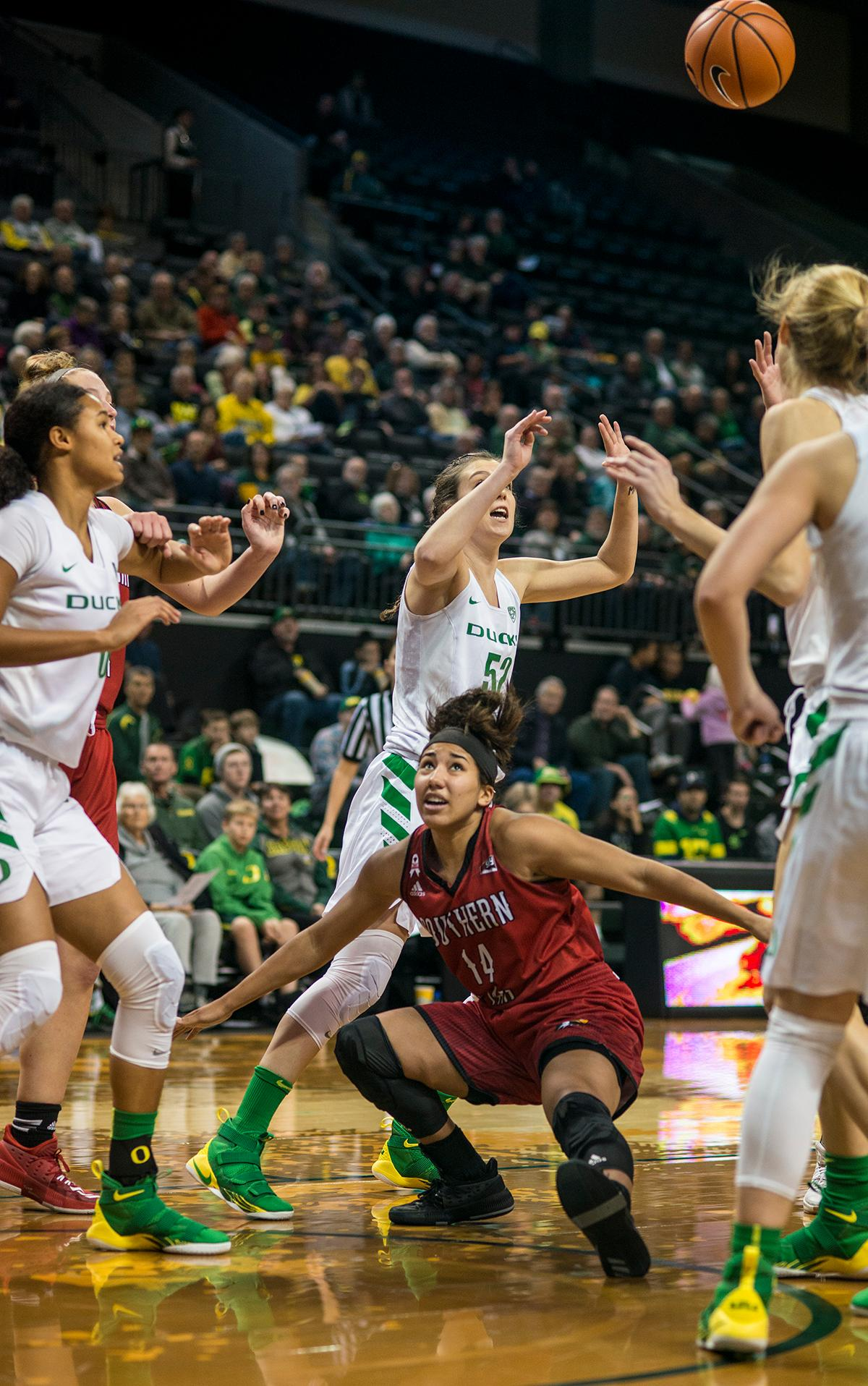 The Oregon Ducks and Southern Utah Thunderbirds struggle for a loose ball. The University of Oregon Ducks women basketball team defeated the Southern Utah Thunderbirds 98-38 in Matthew Knight Arena Saturday afternoon. The Ducks had four players in double-digits: Ruthy Hebard with 13; Mallory McGwire with 10; Lexi Bando with 17 which included four three-pointers; and Sabrina Ionescu with 16 points. The Ducks overwhelmed the Thunderbirds, shooting 50% in field goals to South Utah's 26.8%, 53.8% in three-pointers to 12.5%, and 85.7% in free throws to 50%. The Ducks, with an overall record of 8-1, and coming into this game ranked 9th, will play their next home game against Ole Miss on December 17. Photo by Rhianna Gelhart, Oregon News Lab