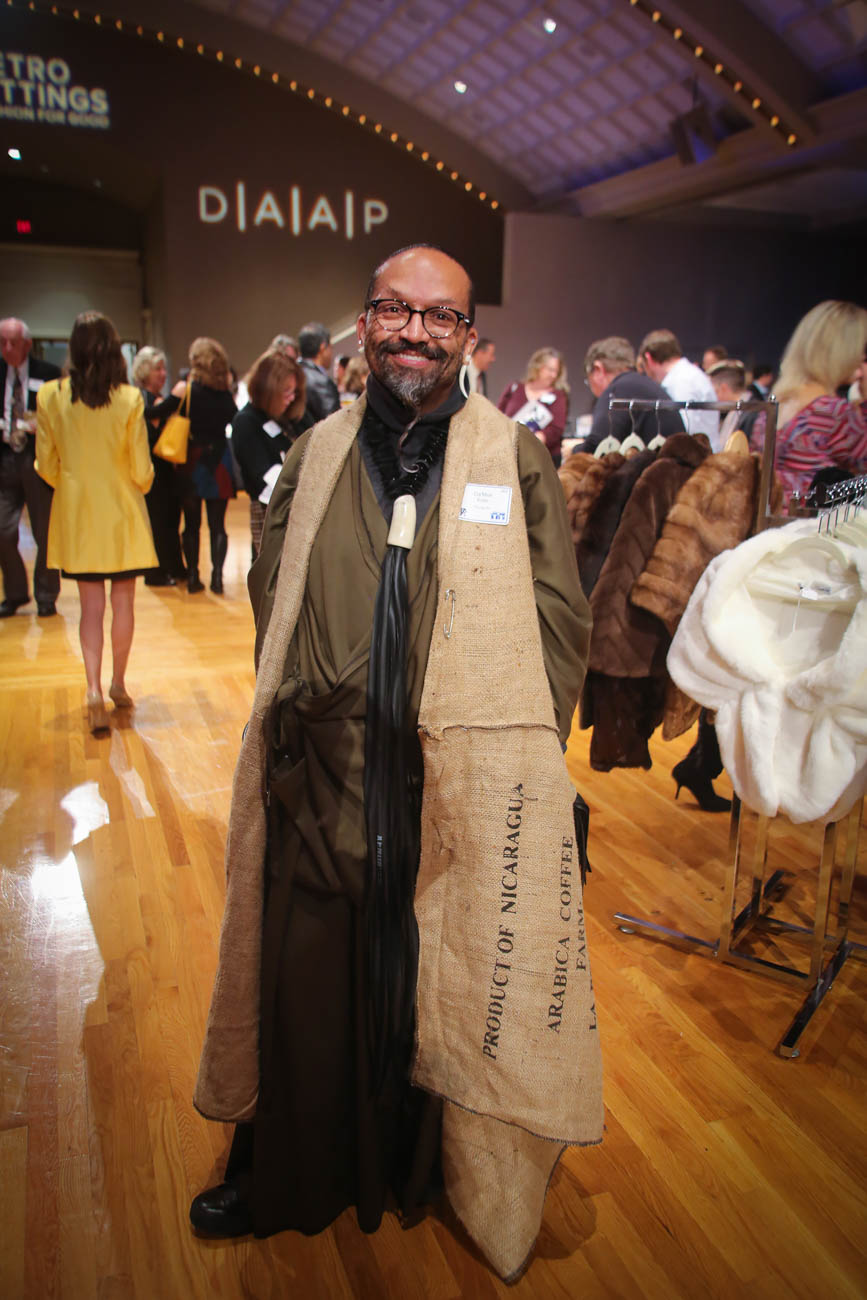 Da'mon Butler (designer) wearing his own vest made from upcycled coffee bags with a necklace made from upcycled rubber tires / Image: Ann Van Epps // Published: 10.19.18