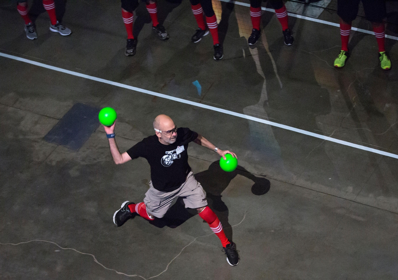 A participant takes aim during one of the dodgeball tournaments at the 6th annual Geekwire Bash at the CenturyLink Event Center. (Sy Bean / Seattle Refined)
