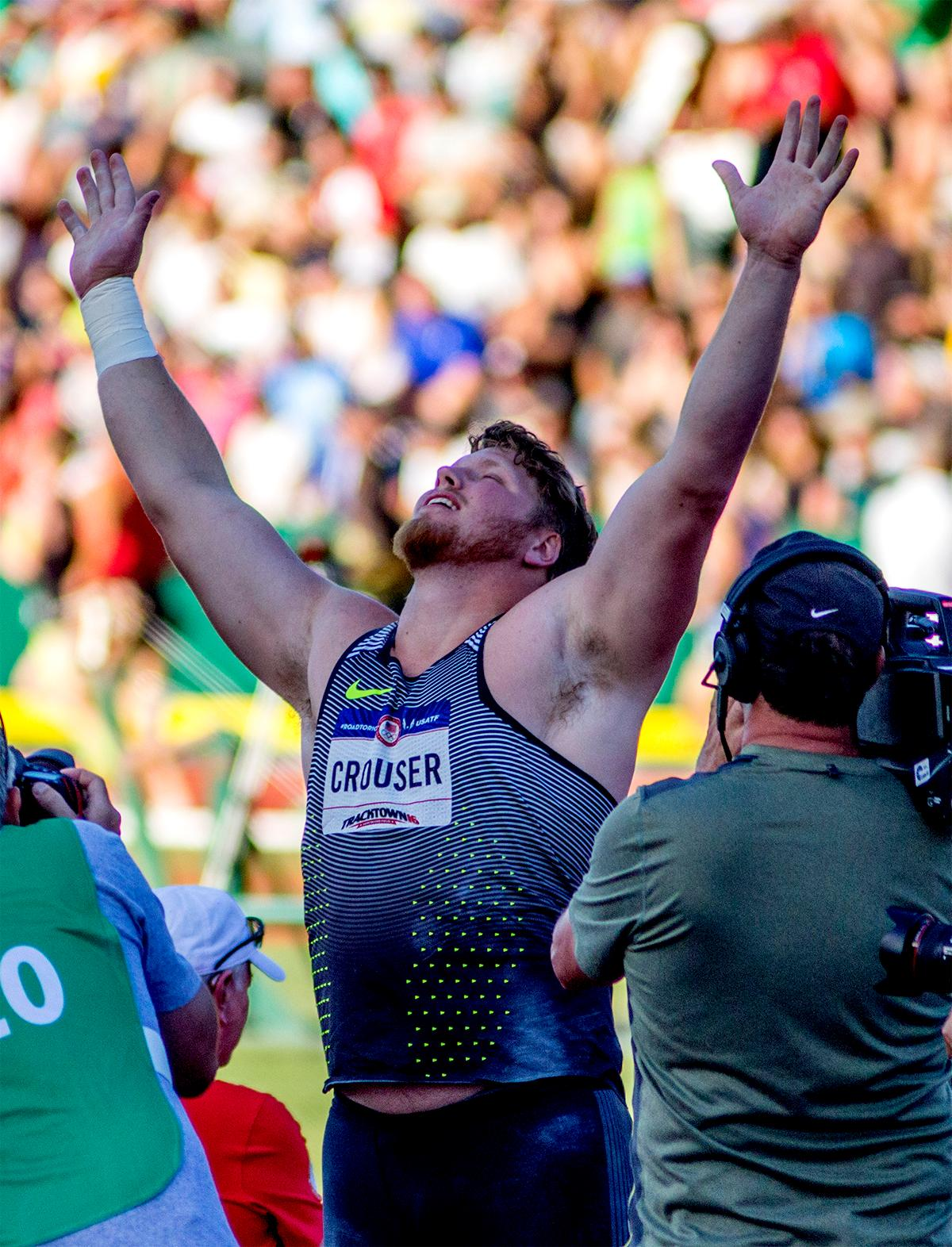 Nike's Ryan Crouser throws his arms up upon winning the mens shot put competition. Crouser won with a final distance of 20.97m. Day one of the U.S. Olympic Trials Track and Field began on Friday at Hayward Field in Eugene, Oregon and will continue through July 10. Photo by August Frank, Oregon News Lab