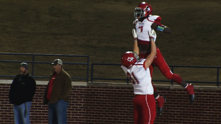 Johnny Bizzell celebrates with a Carl Albert teammate after a long touchdown run during the McGuinness game on Friday, Dec 2, 2016.(Anthony West / KOKH)