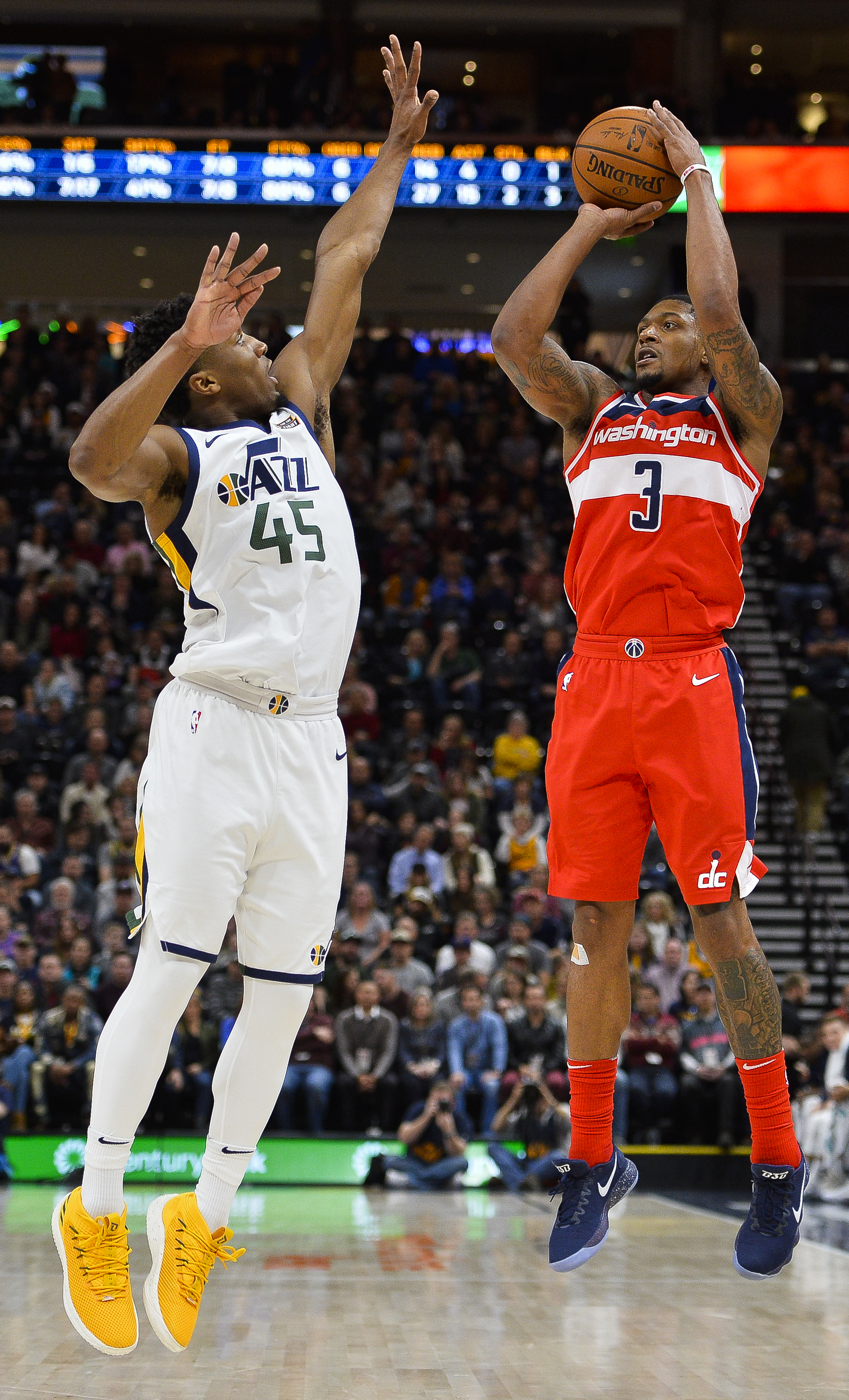 Utah Jazz guard Donovan Mitchell (45) attempts to block Washington Wizards guard Bradley Beal (3) in the first half of an NBA basketball game Monday, Dec. 4, 2017, in Salt Lake City. (AP Photo/Alex Goodlett)