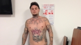 Hot weather could force fugitive to show off distinctive tattoos