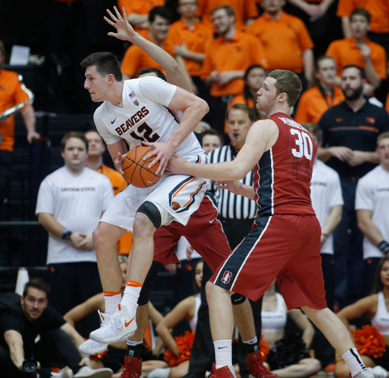 Oregon State's Drew Eubanks (12) jumps past Stanford's Grant Verhoeven (30) during the first half of an NCAA college basketball game in Corvallis, Ore., Thursday, Jan. 19, 2017. (AP Photo/Timothy J. Gonzalez)
