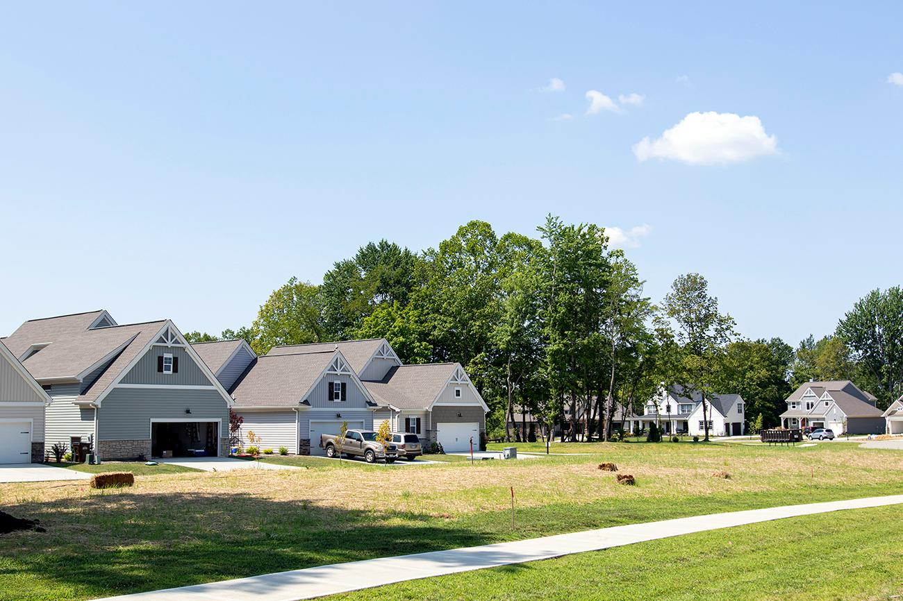 <p>The farming colony is built much like a golf course neighborhood, but instead of a golf course, the farm is at the center. They offer a range of home lots for residents to purchase and build their cottage on, featuring a variety of floor plans. / Image: Allison McAdams // Published: 8.19.19<br></p>