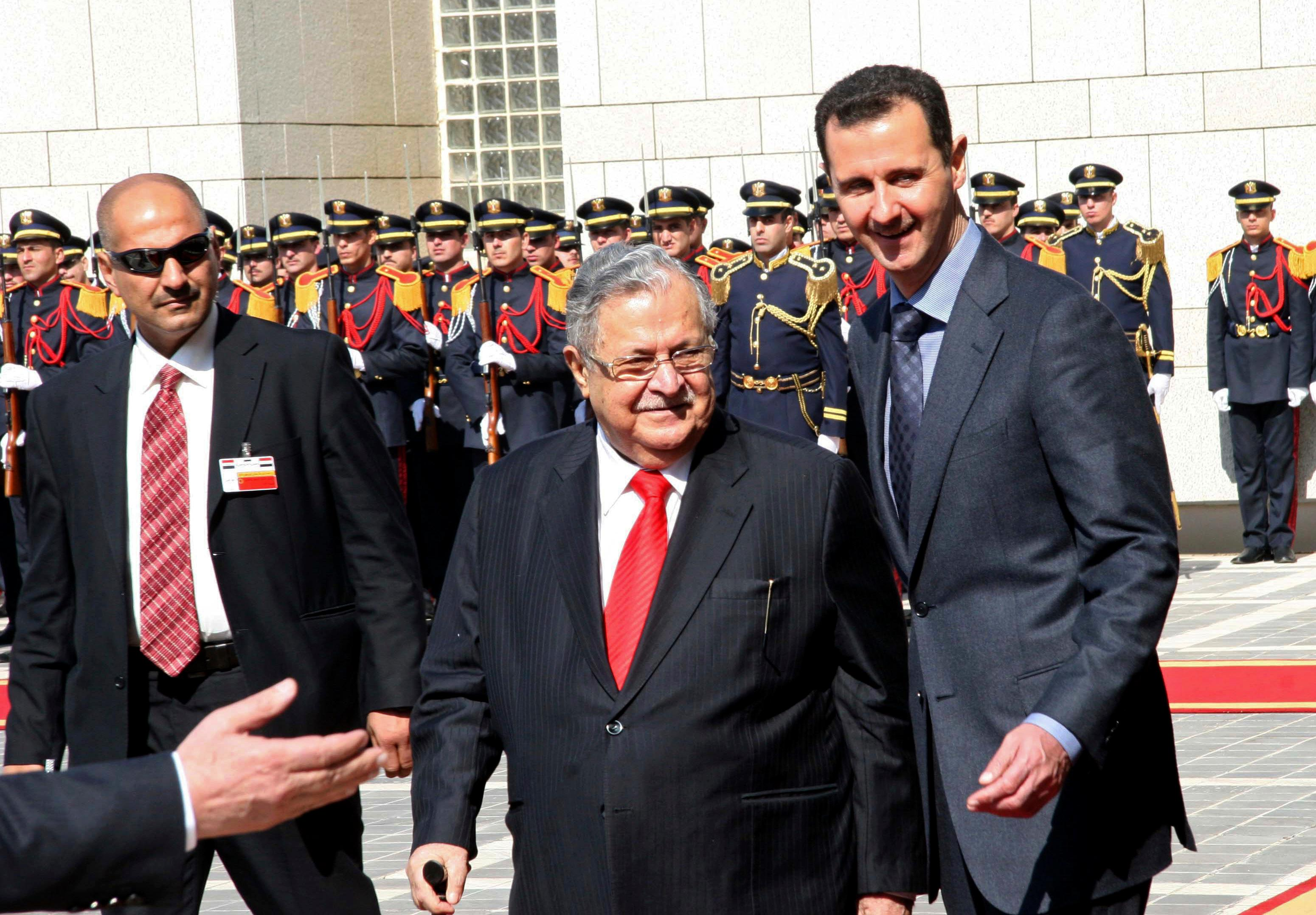 FILE - In this Feb. 12, 2011 file photo, Syrian President Bashar Assad, right, receives his Iraqi counterpart Jalal Talabani, center, upon his arrival at al-Shaab presidential palace in Damascus, Syria. Talabani, a lifelong fighter for Iraq's Kurds who rose to become the country's president, presenting himself as a unifying father figure to temper the potentially explosive hatreds among Kurds, Shiites and Sunnis has died in a Berlin hospital at the age of 83. (AP Photo/Bassem Tellawi, File)