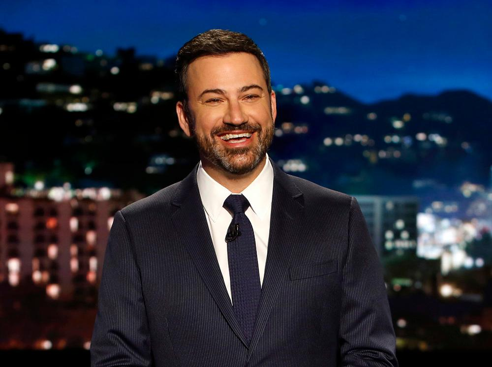 "In this April 11, 2017 photo, host Jimmy Kimmel appears during a taping of ""Jimmy Kimmel Live,"" in Los Angeles. Kimmel says his newborn son is home and doing great after open-heart surgery. A tearful Kimmel turned his show's monologue Monday, May 1, into an emotional recounting of the crisis with what Kimmel called a ""happy ending.""                   (Randy Holmes/ABC via AP)"