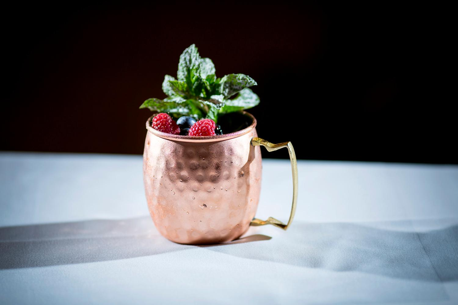 Bronze Twizzle - Makers Mark Bourbon, Aperol, guava juice and fresh squeezed grapefruit and lemon juice mixed with ginger beer and served in a copper mug and garnished with fresh mint and berries. The Fairmont Olympic Hotel put together a special cocktail menu with gold, silver and bronze themed cocktails for the 2018 Winter Olympics. The games will be shown on TV in the Terrace Lounge and guests can enjoy one of the themed cocktails from the special Winner Takes All cocktail menu and learn a bit more about the Olympics along the way. Fun fact: Did you know figure skating which debuted as a summer sport in the 1908 Olympics in London officially became a winter sport at the first ever winter games in the 1924 Olympics in Chamonix, France? (Sy Bean / Seattle Refined)