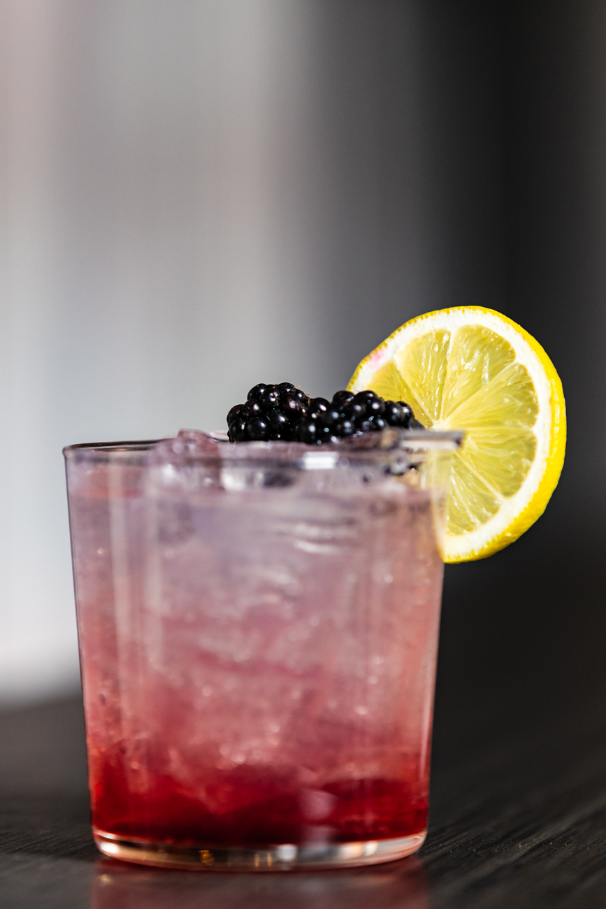 The Banks Bramble made with Aviation Gin, fresh lemon juice, house-made simple syrup, Chambord Raspberry Liqueur, garnished with local, organic blackberries and lemon / Image: Amy Elisabeth Spasoff // Published: 11.28.18