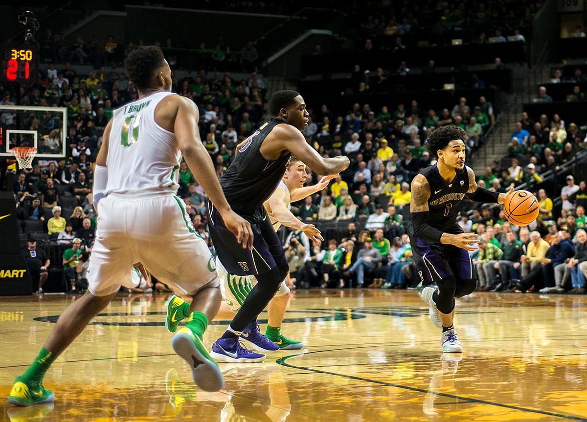 Washington Huskies guard David Crisp (#1) drives the ball toward the Ducks' basket. The Oregon Ducks defeated the Washington Huskies 65-40 on Thursday night at Matthew Knight Arena. Troy Brown, Junior led Oregon with 21 points to match his career high, and Kenny Wooten set a career best of seven shots blocked. The Ducks now stand 6-5 in the Pac-12 conference play. Photo by Abigail Winn, Oregon News Lab
