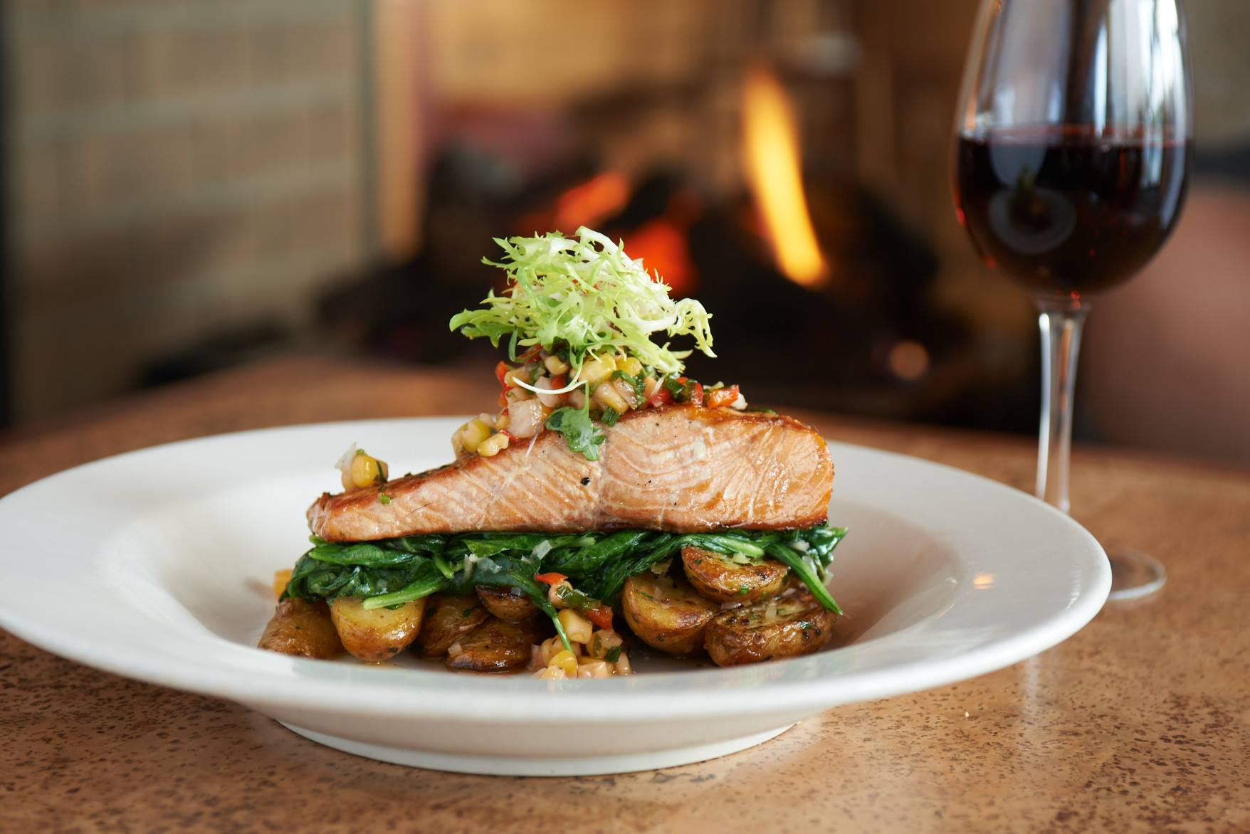 It doesn't get more iconic than salmon at Ivar's.  Grilled on an alderwood plank grill, Ivar's showcases northwest salmon to its full glory. (Image: Ivar's)