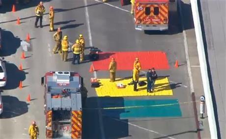 In this aerial video frame grab provided by CBS-LA, fire and rescue personnel gather at Los Angeles International Airport on Friday Nov. 1, 2013.