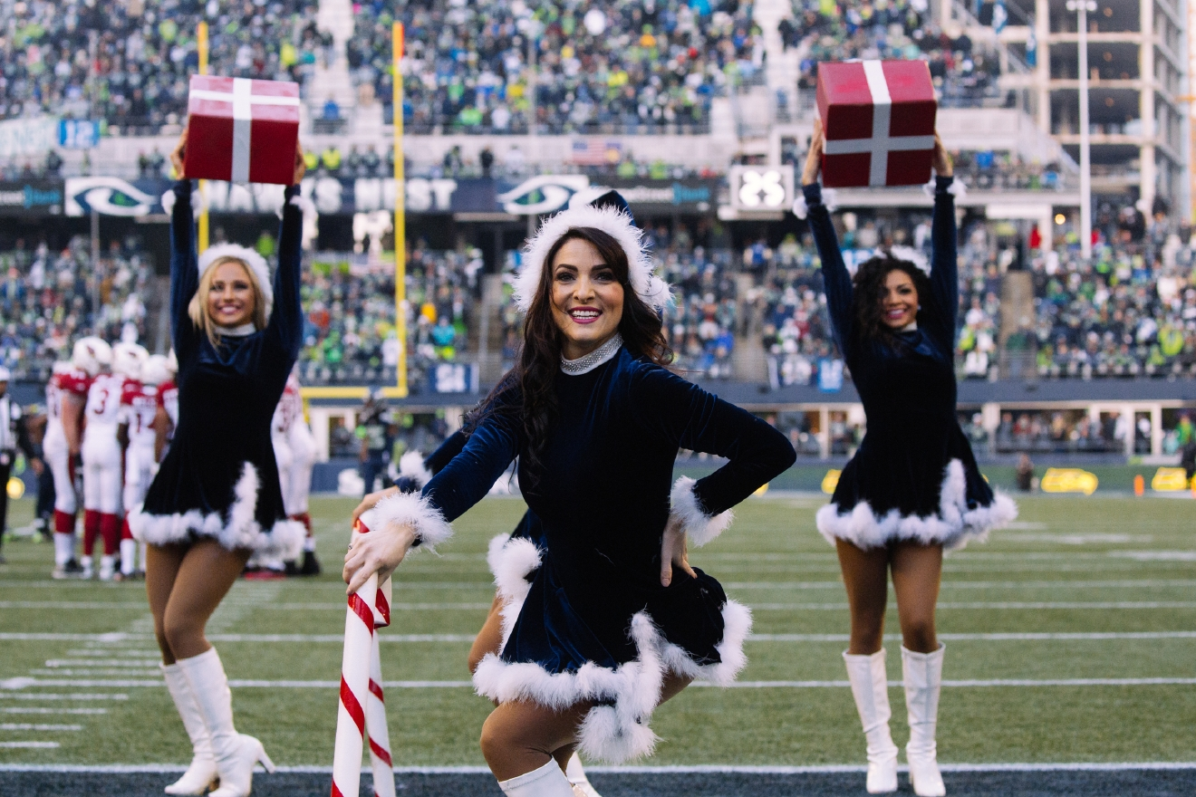 The Sea Gals and 12s get in the holiday spirit as the Seahawks take on the Cardinals on Christmas Eve. This is Seattle's final home game of the regular season and look to go 8-0 at home this year. The Sea Gals equipped with candy canes and presents perform throughout the game. December 24th 2016. (Image: Joshua Lewis / Seattle Refined)