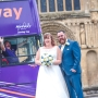 Bus driver photobombs newlyweds' pic