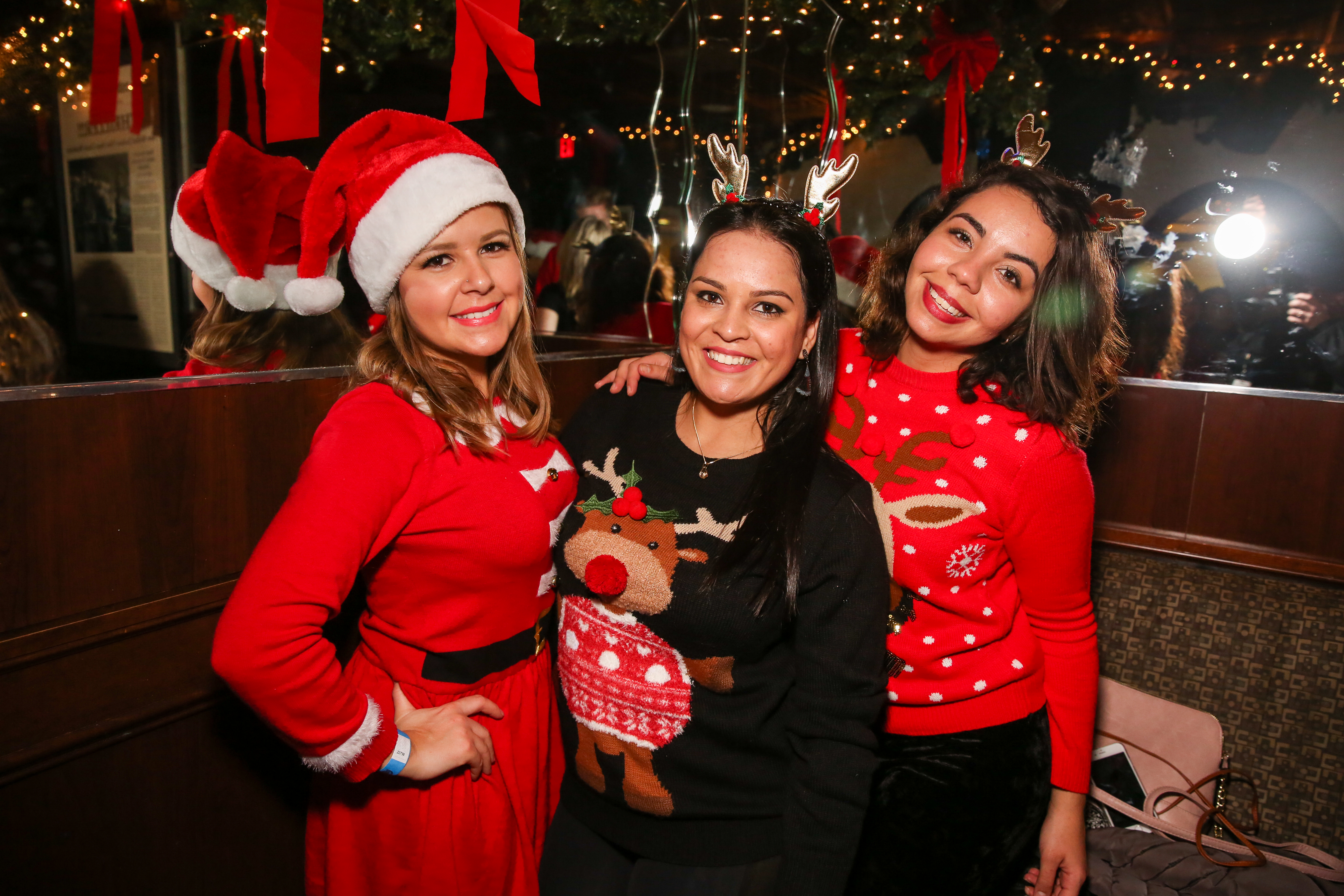 Hundreds of revelers clad in Christmas gear flooded bars in Dupont for Santa Con on December 9. The annual event gives people the chance to bar hop in costume while sipping on more than a little eggnog. (Amanda Andrade-Rhoades/DC Refined)