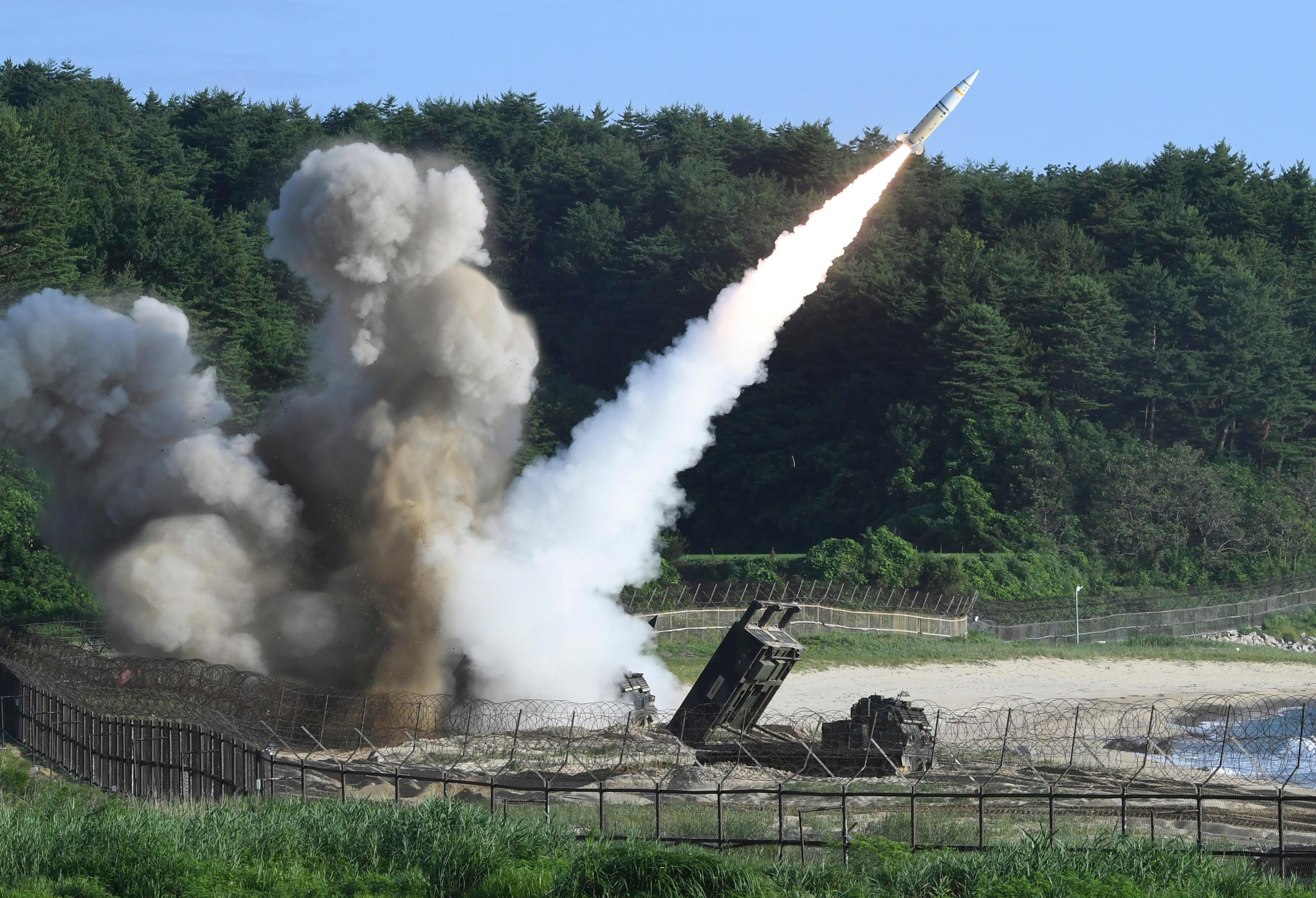 In this photo provided by South Korea Defense Ministry, a U.S. MGM-140 Army Tactical Missile is fired during the combined military exercise between the U.S. and South Korea against North Korea at an undisclosed location in South Korea, Wednesday, July 5, 2017. (South Korea Defense Ministry via AP)