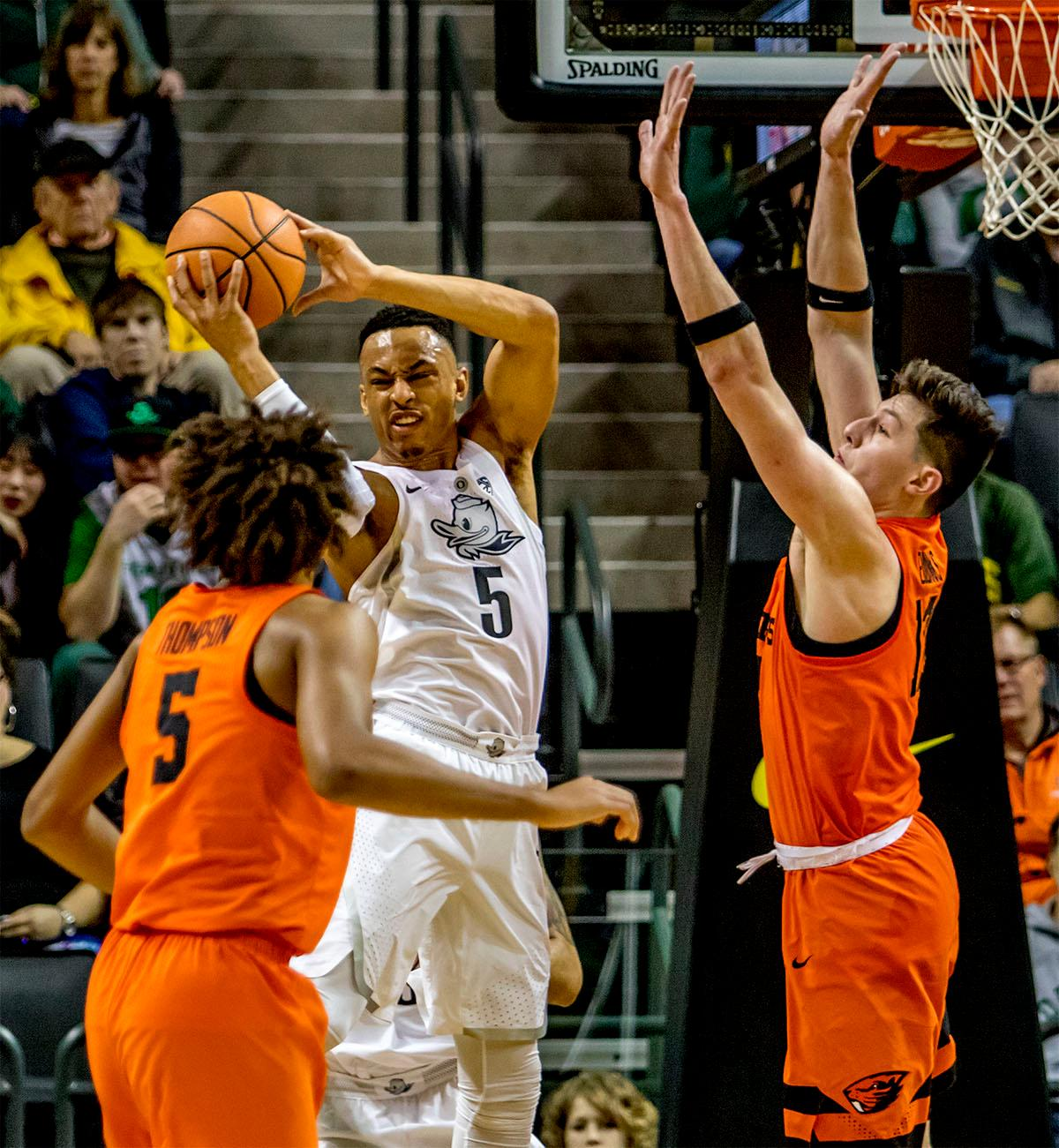 The Duck's Elijah Brown (#5) makes the rebound against the Beavers. The Ducks defeated the Beavers in the civil war game, 66-57, at Matthew Knight Arena on Saturday night. Elijah Brown scored a game high of 20 points with 18 of the points coming in the first half, Paul White added 17 points. The Ducks are now 14-7 overall and 4-4 in conference play. The Ducks will next face California on Thursday Feb. 1 at 6:00 p.m. Photo by August Frank, Oregon News Lab