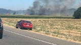 Grass fire near Jefferson destroys two abandoned homes