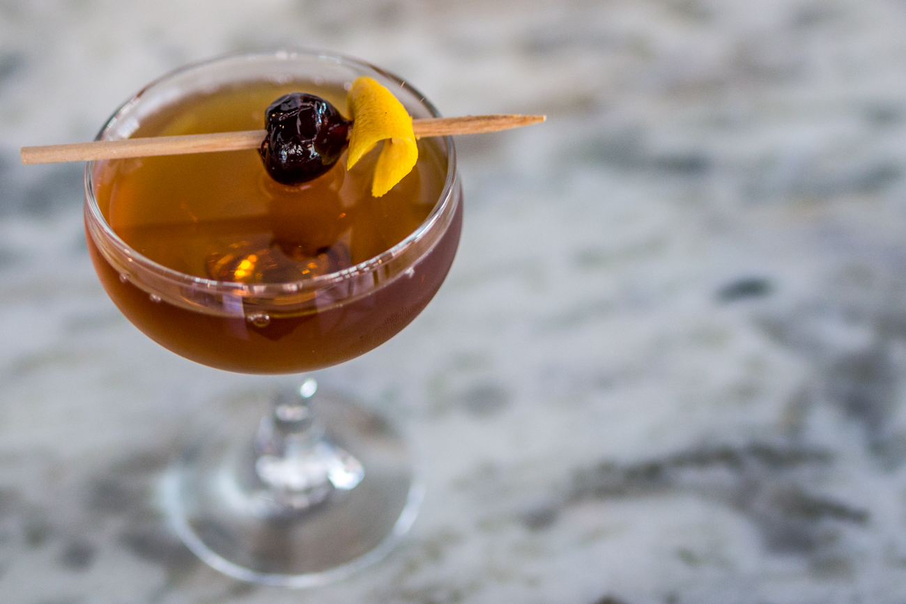 Nero Manhattan: rye whiskey, Amaro liqueor, orange, and black walnut / Image: Catherine Viox{ }// Published: 7.12.19