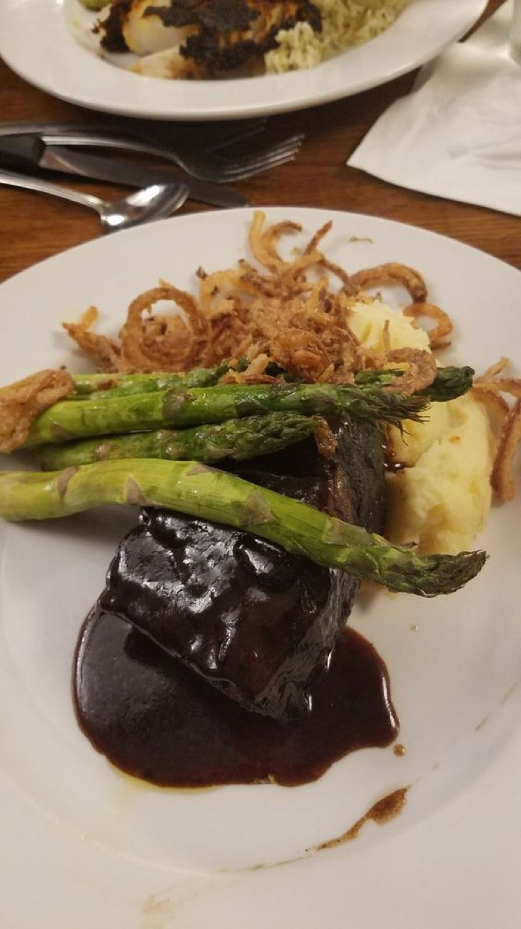 Braised short rib with whipped potatoes, oven-roasted asparagus and a garnish of crispy onions / Image courtesy of Nick and Tom's // Published: 7.11.18
