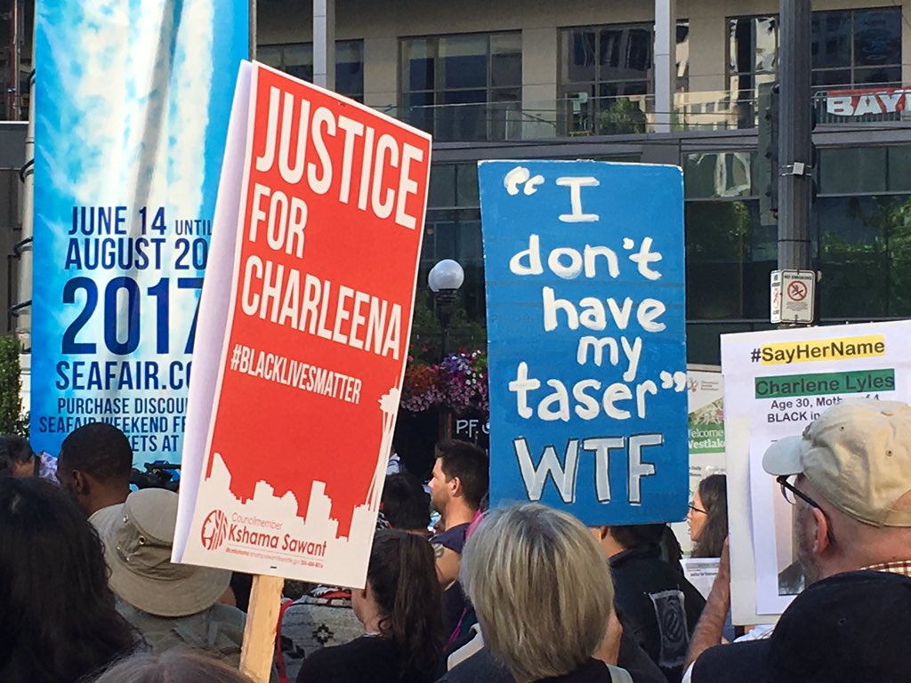 Protest signs against the Seattle Police Department appear at a 2017 rally supporting Charleena Lyles who was shot and killed by police officers after she refused to drop a kitchen knife. (photo: KOMO News)