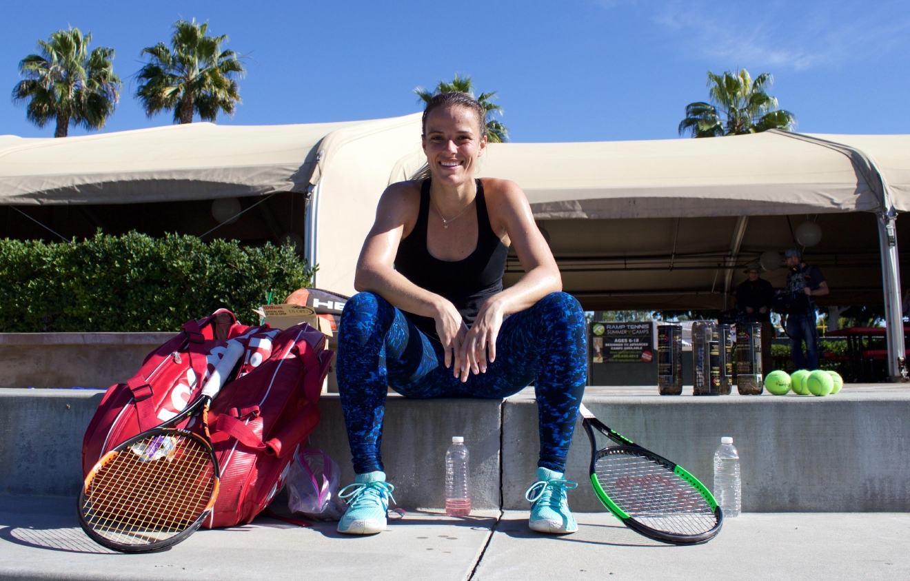 Nicole taking a quick break while on court shooting the 'My Tennis Life' trailer