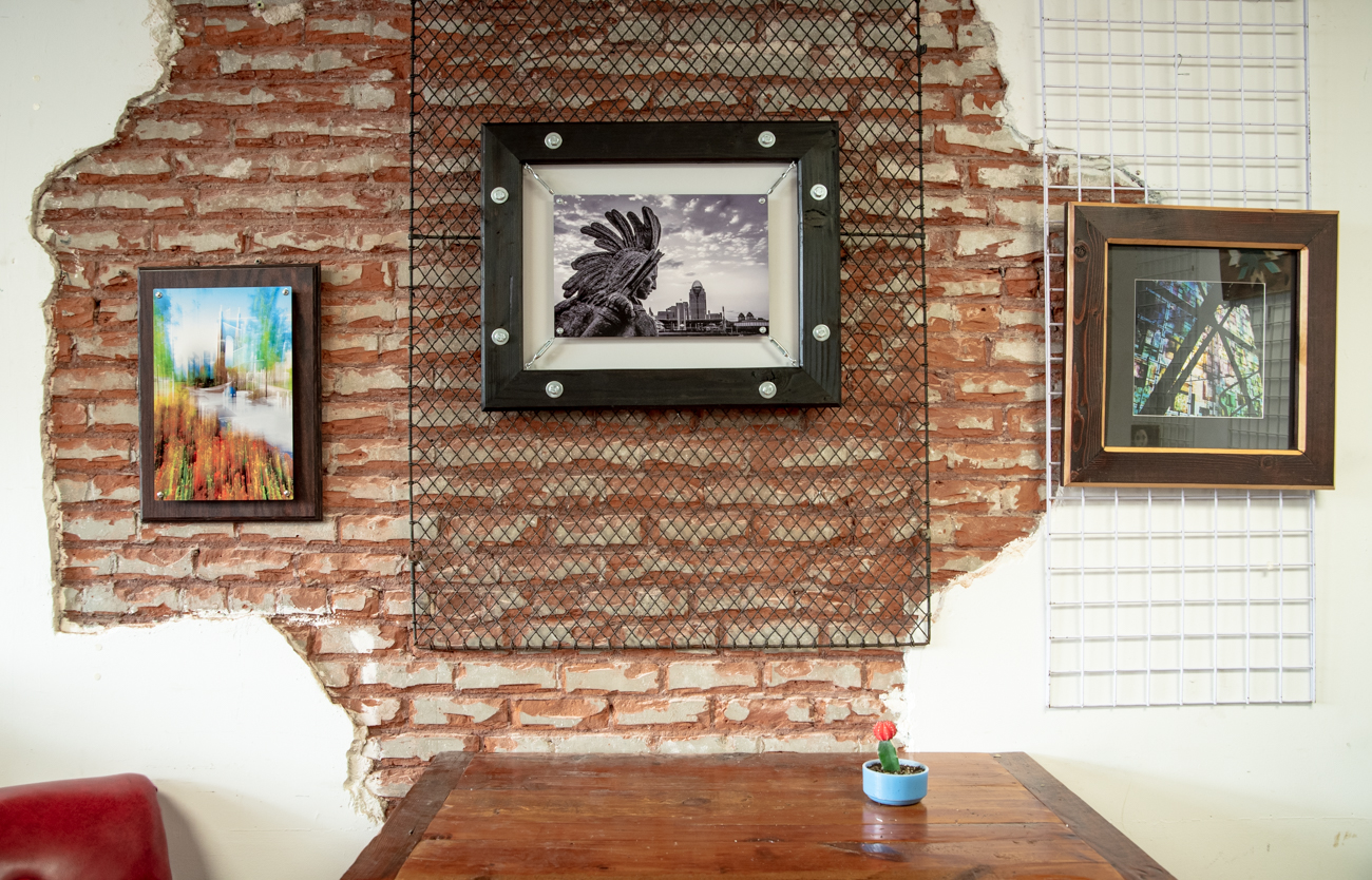 Ryan Hill with ImageNationS Photography is a Newport-based photographer who uses his carpentry skills to design and create his own unique framing. His style ranges from classic black & white cityscapes, to images inspired by abstract expressionism. / Image: Melissa Sliney // Published: 6.26.19<br>