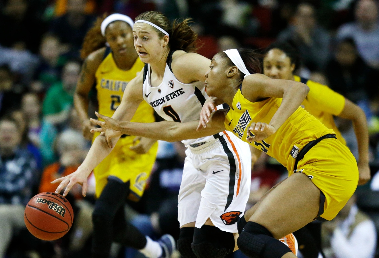 Oregon State guard Mikayla Pivec, center, tries to fend off California forward Kristine Anigwe, right, in the first half of an NCAA college basketball game in the Pac-12 Conference tournament, Friday, March 3, 2017, in Seattle. (AP Photo/Ted S. Warren)