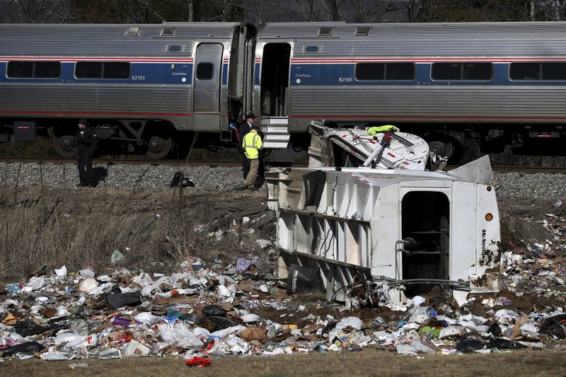 <p>Emergency personnel work at the scene of a train crash involving a garbage truck in Crozet, Va., on Wednesday, Jan. 31, 2018. An Amtrak passenger train carrying dozens of GOP lawmakers to a Republican retreat in West Virginia struck a garbage truck south of Charlottesville, Va. (Zack Wajsgrasu/The Daily Progress via AP)</p>
