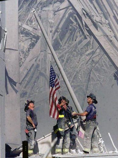 5:00 p.m.: As rescue workers continue to go through the rubble, New York City firemen hoist an American flag at the site of the World Trade Center -- an iconic image often compared to the World War II photo of the raising of the flag on Iwo Jima.