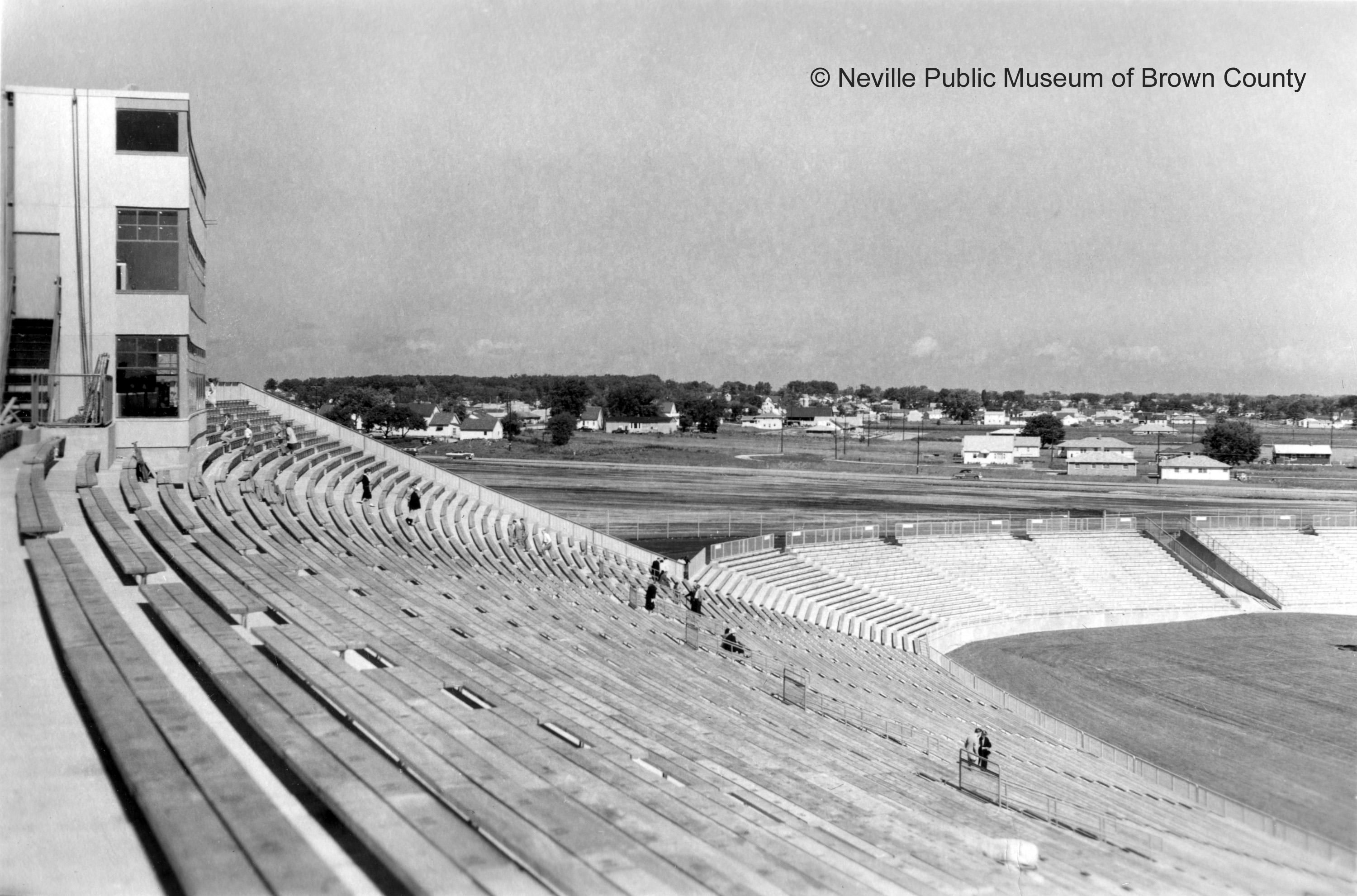 New City Stadium construction nearly complete in 1957, and view of surrounding community at the time. (Courtesy: Neville Public Museum of Brown County)